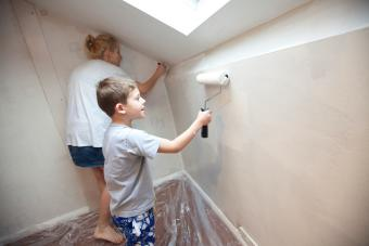 Mother and son decorating a bedroom.