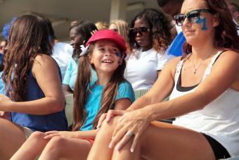 Enjoying baseball game with mother