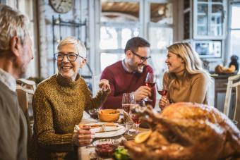 woman talking to her husband during Thanksgiving