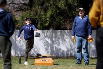 Playing cornhole with family