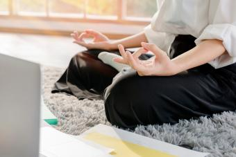 Woman working at home with a notebook Relaxing by meditating