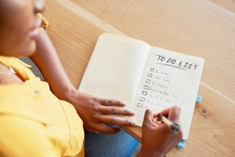 Woman checking off boxes on her to-do list
