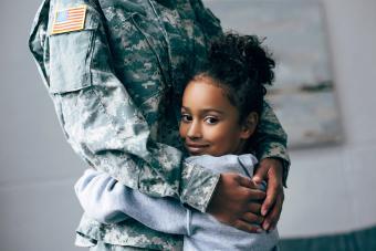 Daughter hugging soldier