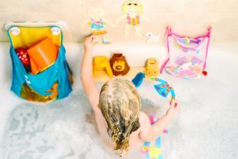 Overhead shot of little girl playing in bath