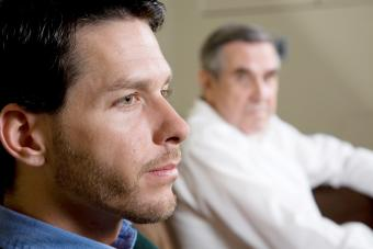 Closeup of man with father looking on