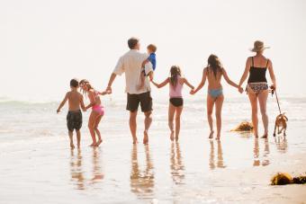 Family of seven walks on the beach