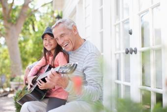 Grandparent granddaughter playing guitar