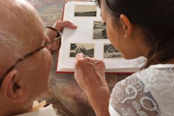 Grandfather and granddaughter looking photo album