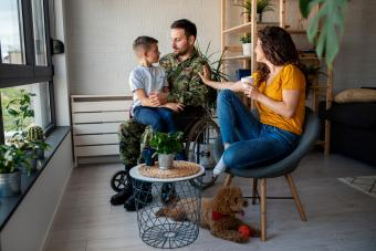 Male Veteran In Wheelchair with his family
