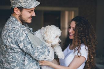 Solider and girl with dog