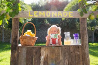 Girl on lemonade stand