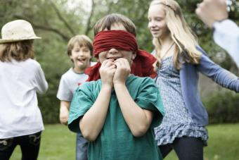 Blindfold kid playing a game