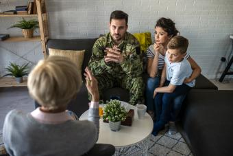 Soldier and his family at a psychotherapist during a session
