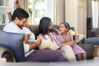 Parents having fun with children at home