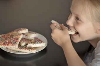 Young Australian girl eating fairy bread