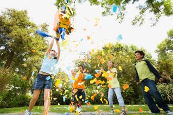 Children hitting pinata at birthday party