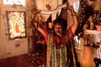 Voodoo Spiritual Woman Holding Snake
