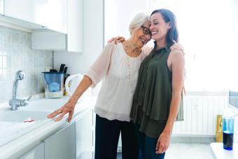 Smiling granddaughter and grandmother hugging