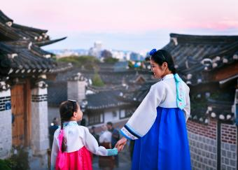 Korean Mother And Daughter Standing At Temple