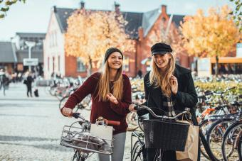 Young women leading their bikes in Sweden