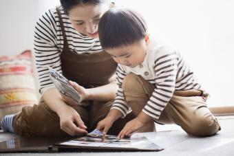 Mother and son making a photo album together