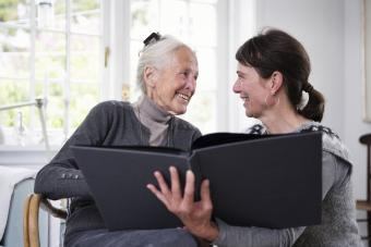 Two generation women looking in photo album together
