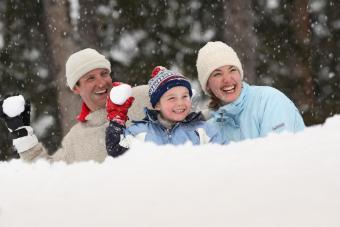 Father, mother and son throwing snow balls