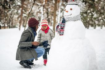 Making snowman with friends and family