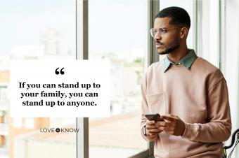man looking out window inspired to stand up to family