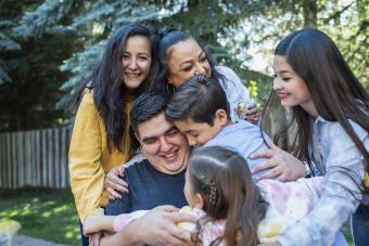 family group hug around father