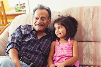 granddaughter looking at grandfather