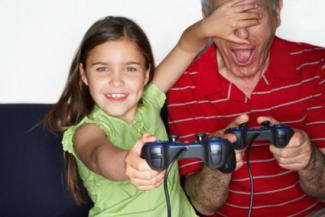 Grandfather and girl playing video game