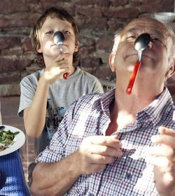 Grandfather and grandson playing with spoon