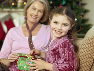 Grandchild holding gift from grandmother