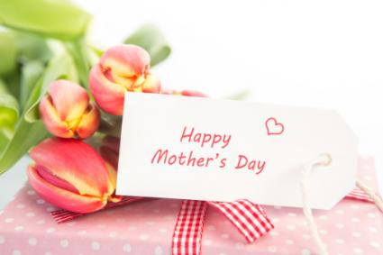 flowers and gift with mothers day card