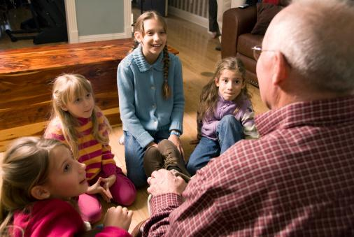 Grandfather telling a story to Grandchildren