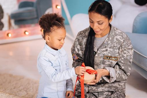 child giving military mom a gift
