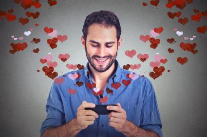 Man sending love text to spouse