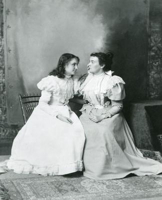 Helen Keller listens to Anne Sullivan