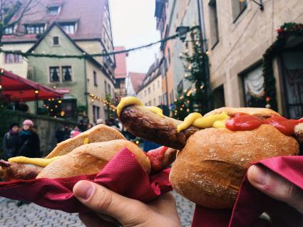 Eating bratwurst at German Christmas market