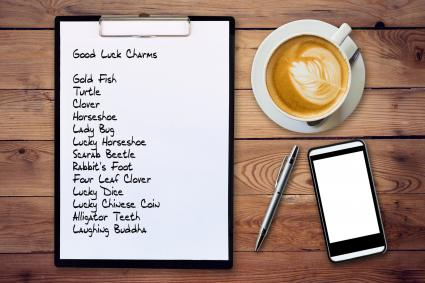 Good luck charms list on clipboard
