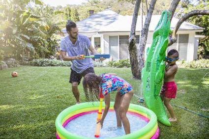 Family having a water fight