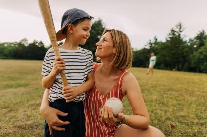 Mom supporting her son's interest in baseball