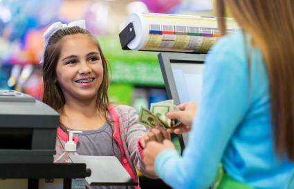 Little girl paying for purchases