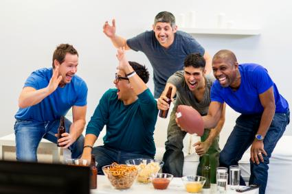 A group of guys watching American Football together