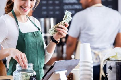 Barista pulls money from tips jar