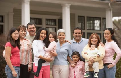 Large family standing in front of house