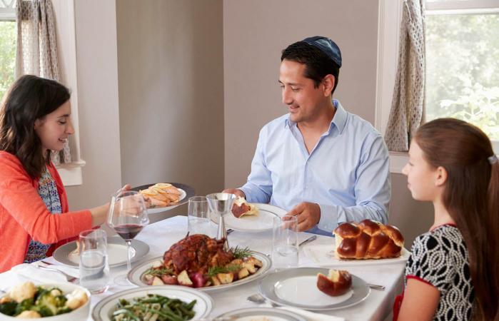 Jewish family at Shabbat meal