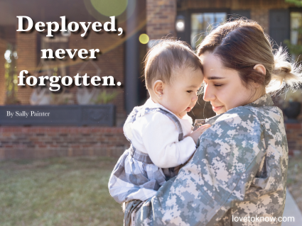 Military woman on deployment holding her baby