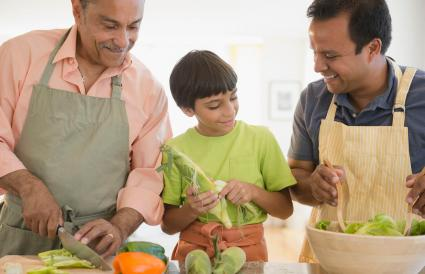 grandfather, father and son preparing food